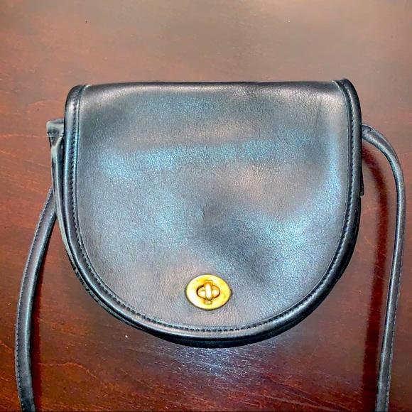 Vintage coach black leather small saddle bag